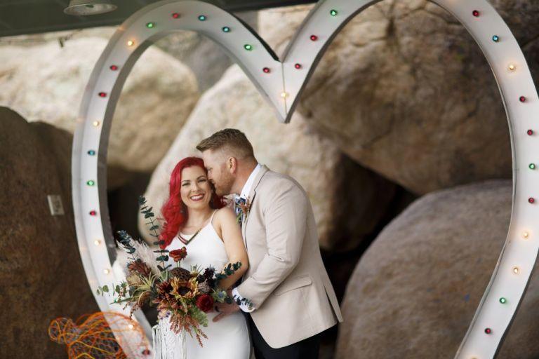 hipster couple at a bohemian desert junkyard wedding