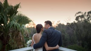 couple kissing while looking at the view from their san diego zoo wedding