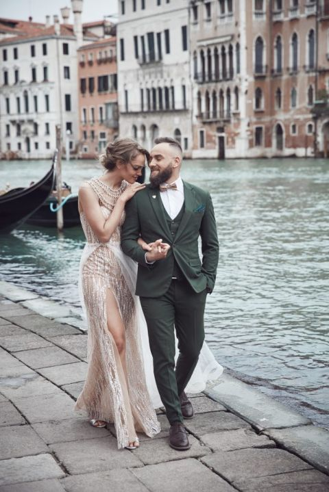 elegant Bride and groom walk along Venice canal after their luxury wedding, San Diego event designed by Ivory and Lace Creative Weddings